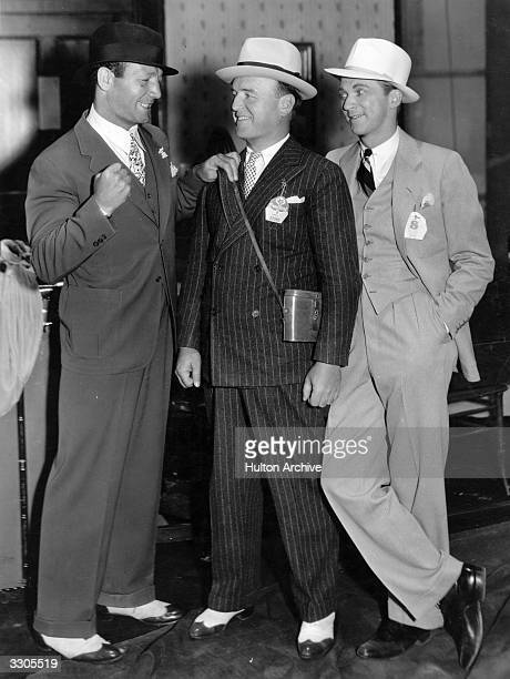 Maxie Rosenbloom the world's light heavyweight boxing champion turned actor, prepares to punch-out William Frawley on the chin whilst Lee Tracy looks...