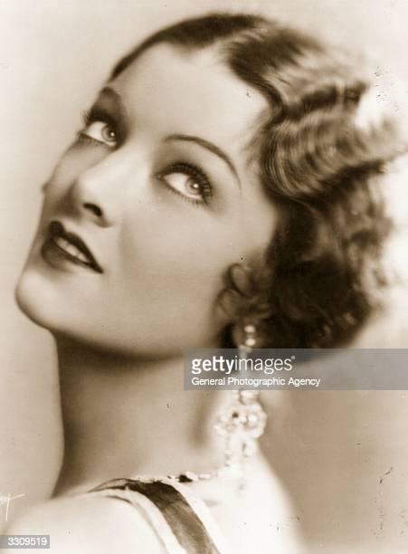 Myrna Loy the Hollywood film actress usually cast as an exotic vamp In 1936 the height of her career she was declared 'Queen of the Movies'