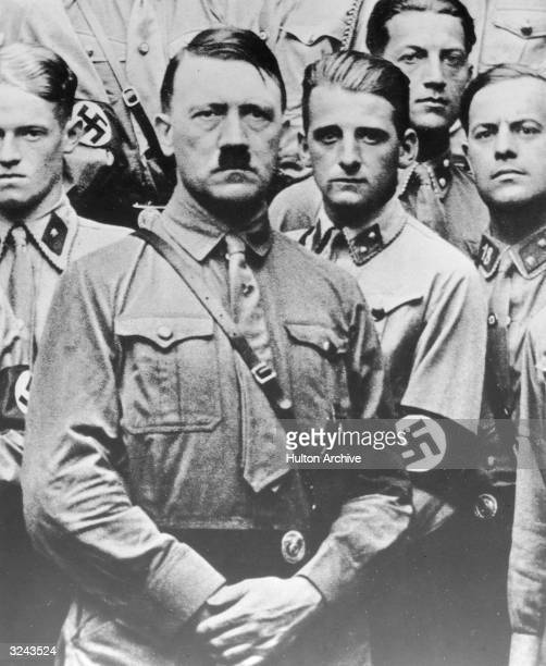 Nazi leader Adolf Hitler wears an SA uniform with young 'Brownshirt' soldiers