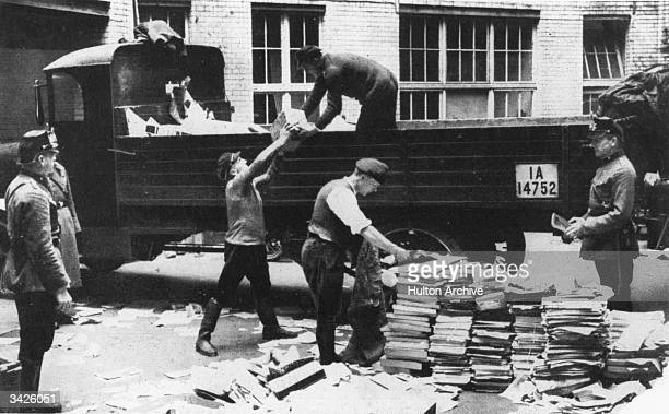 Nazi's supervising the loading of seized documents on to a lorry following antiCommunist raids