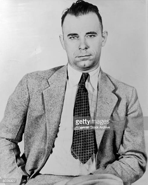 Portrait of American criminal gang leader and bank robber John Dillinger wearing a jacket and tie