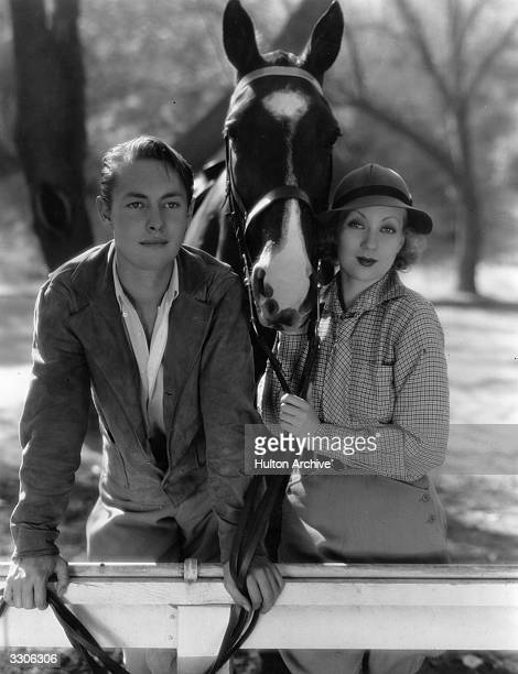 Richard Cromwell the Hollywood film star and actor with Ann Sothern the pert American comedienn on a bridle path in Beverly Hills Both are contracted...