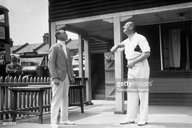 Rival captains Colonel J L McBready and Lieutenant Colonel A C Richardson tossing up before the start of the cricket match between London Transport...