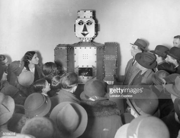 Shoppers admiring a fortune-telling robot at Selfridges Store, London.