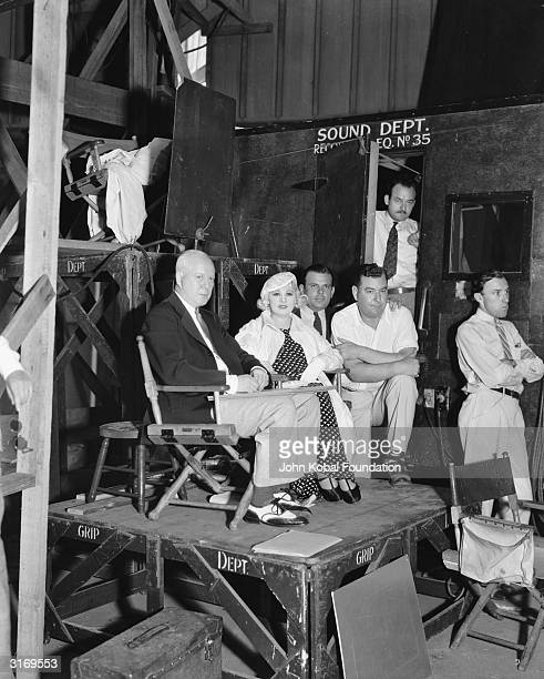 The original Hollywood sex symbol, Mae West in a film studio with other crew members.