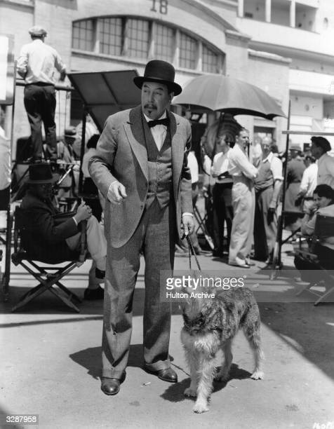 Warner Oland who became famous in Hollywood as Chinese detective Charlie Chan with German Schauzer costar 'ShaggedyAnn' on the set of 'Charlie Chan's...