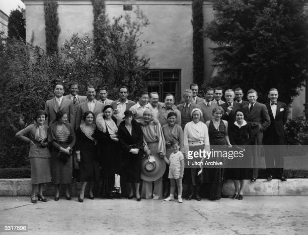 A collection of stars in a studio group photograph amongst them are Carole Lombard Jack Oakie Joel McCrea Fredric March and Charles Ruggles