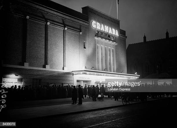 Crowd queuing outside a Granada Cinema in Slough on the night of its 'Grand Opening' by film star Leslie Howard.