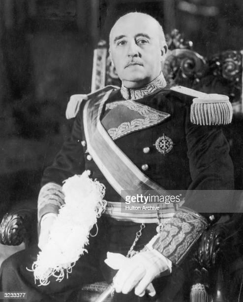 A portrait of Spanish dictator Francisco Franco sitting on a throne in full military regalia