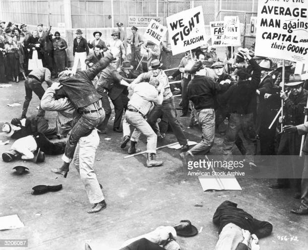 A scene depicting unionized strikers fighting with a group of 'scabs' or nonunion replacement employees as they try to cross the picket line at a...