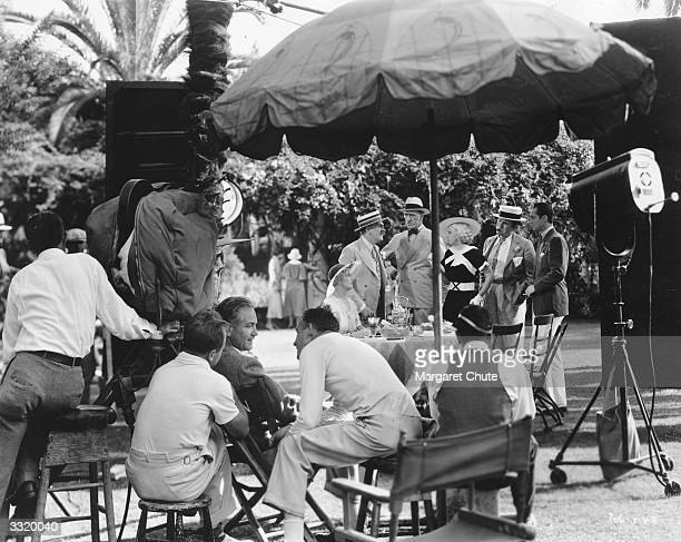 A scene during the filming of 'Blonde Bombshell' with Mary Forbes Frank Morgan C Aubrey Smith Jean Harlow and Franchot Tone on set