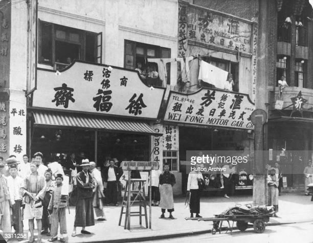 A street scene near the garage of the Wei Fong Motor Car Co Avenue Edouard VIII Shanghai China
