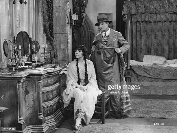 Actors Edmund Lowe and Renee Ado in a scene from the film 'Soul Mates'