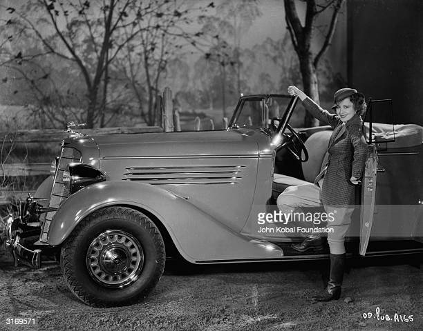 Actress Olivia Mary de Havilland standing next to her car. She was attached to Warner Brothers for most of her acting career until she sued them in...