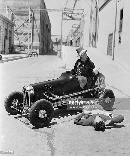 American actor W C Fields born William Claude Dukenfield in the guise of Mr Micawber from the MGM film 'David Copperfield' runs over a pedestrian in...