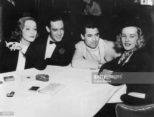 American actress and singer Marlene Dietrich with Michael Brook film actor Cary Grant and Phyllis Brook at the Trocadero in Hollywood