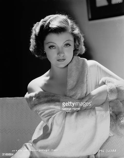 American actress Myrna Loy wearing a furtrimmed dressing gown