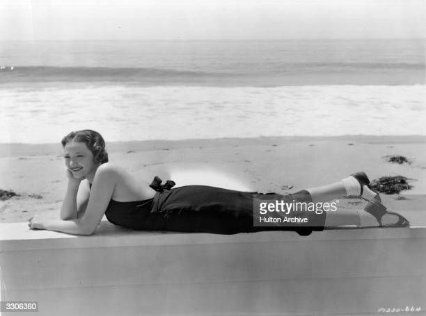 American actress Sylvia Sidney on the beach in front of her Malibu home.