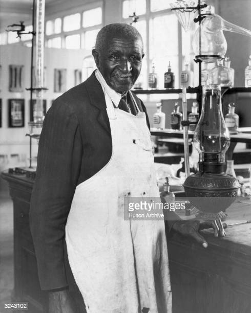 American agricultural chemist Dr George Washington Carver poses in a laboratory