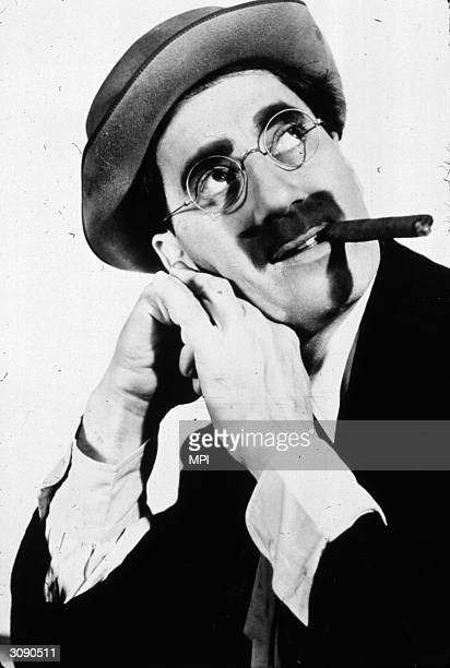 American comedian and actor Groucho Marx whose cigar and moustache became his legendary trademark