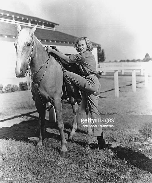 American comic actress Carole Lombard mounting a horse