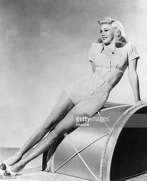 American dancer and actress Ginger Rogers wearing a sun suit with shorts
