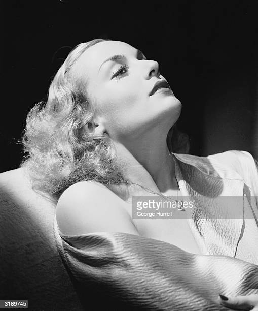 American film actress Carole Lombard lies back and half closes her eyes