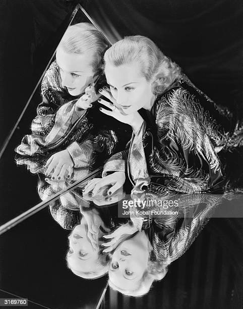 American film actress Carole Lombard reflected in a triangular mirror