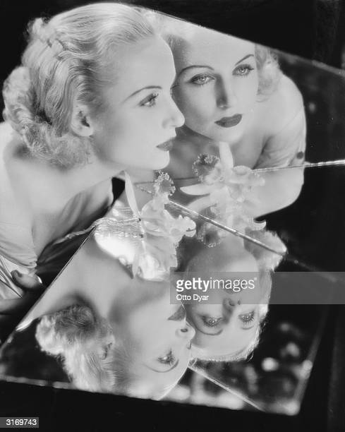 American film actress Carole Lombard reflected in two cracked mirrors