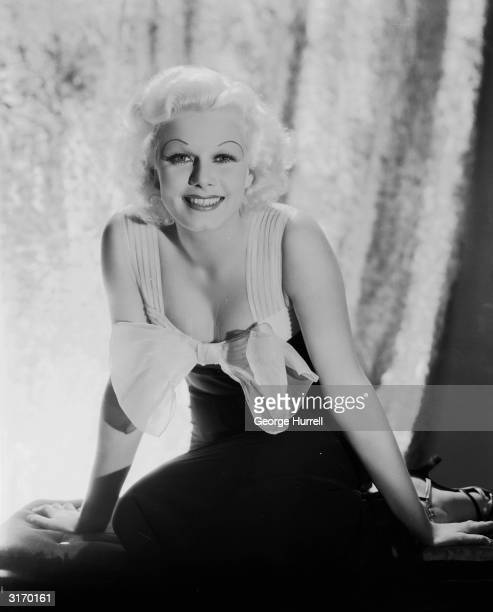 American film star Jean Harlow the blonde bombshell who died tragically young of acute nephritis wearing an evening gown decorated with a large bow