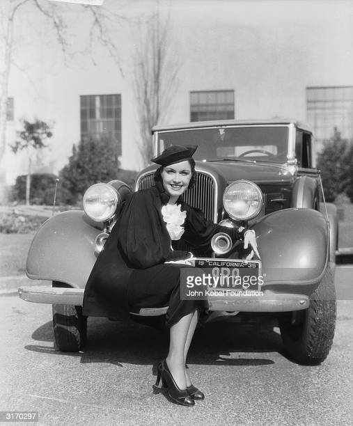 American leading lady Gail Patrick perches on the fender of a car After retiring as an actress she became a television producer notably of the...