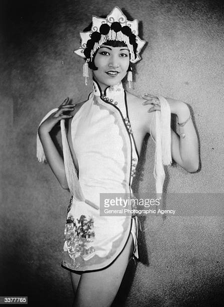 AmericanChinese actress Anna May Wong wearing an Orientalstyle costume and headdress