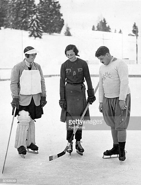 Aviatrix Winifred Brown captain of the Manchester Ladies ice hockey team tossing up before a match in Villars with Claudie de la Faye captain of the...