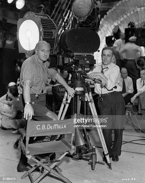 Cecil B DeMille American film director and founder of Paramount Films leans on his director's chair at Paramount studios