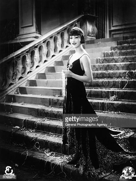 ChineseAmerican actress Anna May Wong formerly Wong Liu Tsong stands alone on a grand staircase in a scene from an unknown film