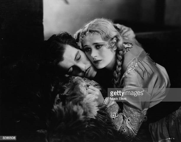 Dolores Costello and Grant Withers in a sorrowful embrace from the film 'Hearts In Exile'
