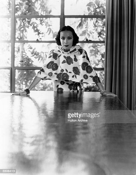 Dolores Del Rio Hollywood film star and wife of MGM's Art Director Cedric Gibbons. Seen in her dining room.