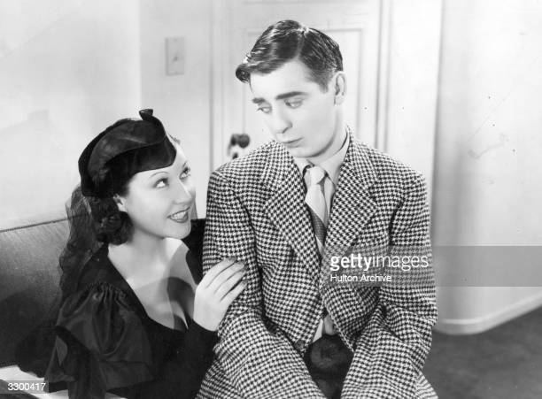 Eddie Cantor the stage name of Edward Israel Itskowitz is looking forlorn while sitting on the lap of Ethel Merman the stage name of Ethel Zimmermann...