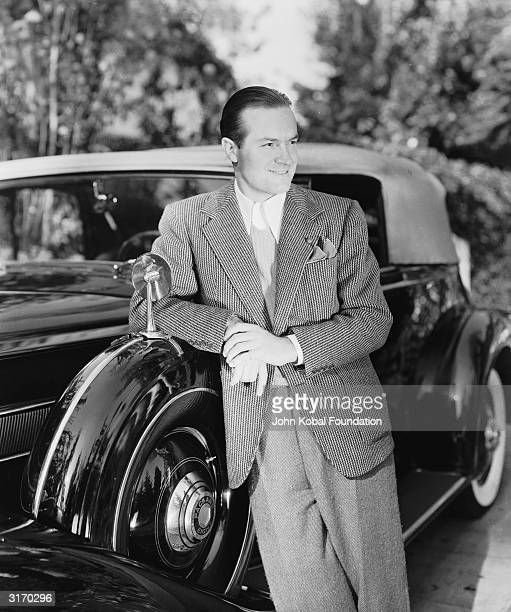 English born American comedian and actor Bob Hope leaning on his Packard Eight Convertible Sedan He spent years in American vaudeville and musical...