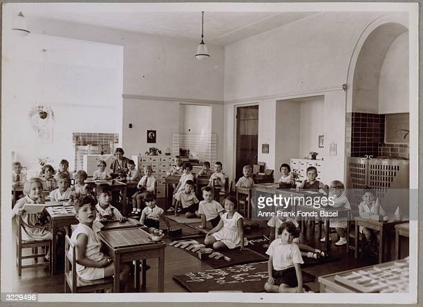 EXCLUSIVE A portrait of Anne Frank's Montessori school class with her teacher Mrs Baldal Amsterdam the Netherlands Anne Frank is sitting at a desk in...