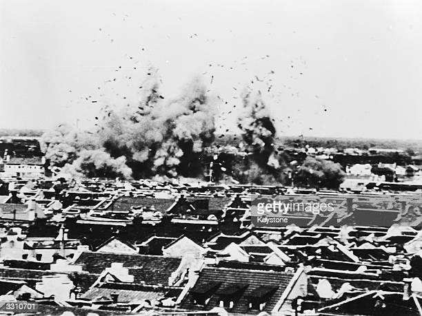 Four Japanese aerial bombs photographed exploding in the Markam Road area of Shanghai