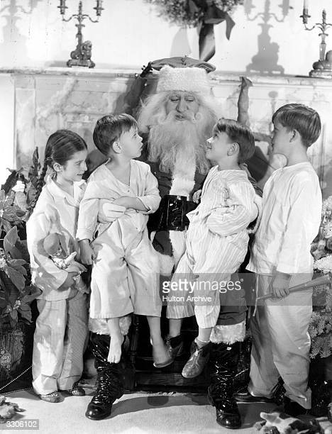 Four of Paramount's child actors are visiting Santa Claus to put in their requests They are left to right Virginia Weidler Baby LeRoy Billy Lee and...