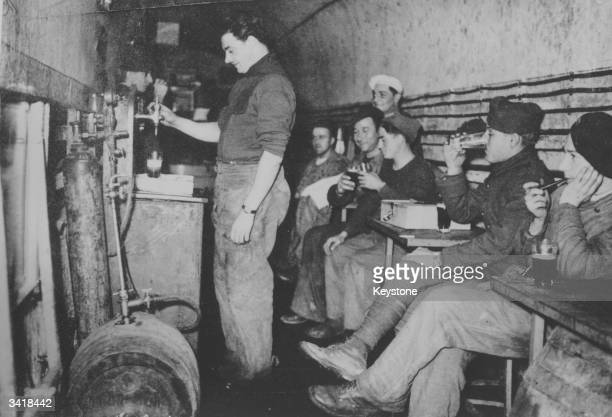 French troops and workers enjoy beer on tap below ground in a casemate of the Maginot Line along the FrancoGerman border