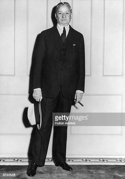 Fulllength portrait of American musical producer Florenz Ziegfeld holding a hat and a cigar