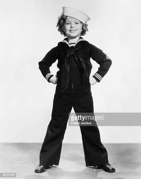 Fulllength studio portrait of American child actor dancer and singer Shirley Temple wearing a sailor's uniform and cap