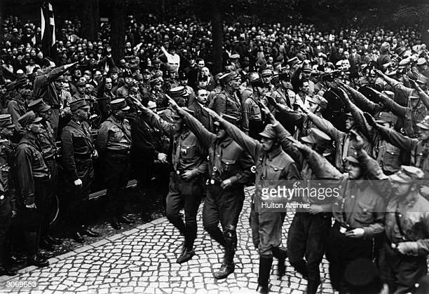 German dictator Adolf Hitler takes the salute at a Nazi parade in Germany