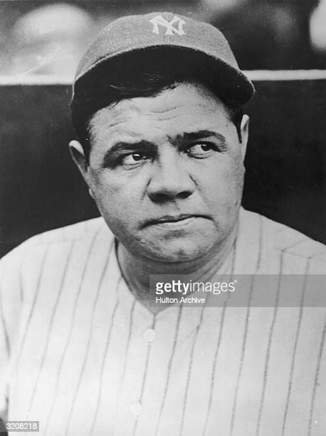 Headshot of American baseball player Babe Ruth wearing his New York Yankees uniform and cap