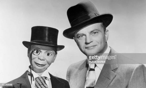 Headshot of American ventriloquist Edgar Bergen with his dummy Charlie McCarthy Bergen is wearing a suit and a hat Charlie McCarthy is dressed in...