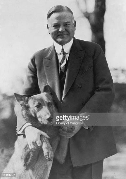 Herbert Hoover , the 31st President of the United States, with his dog.