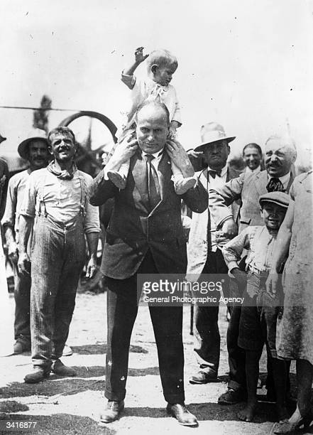 Italian dictator Benito Mussolini with his youngest son Romano on his shoulders